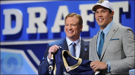 NFL commissioner Roger Goodell greets top pick Bradford