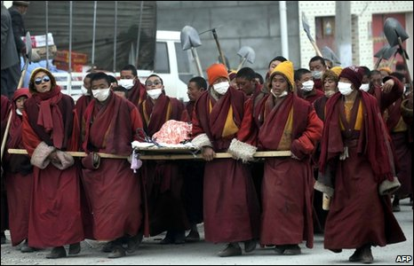 Monks carry a body in a funeral procession in Jiegu town, Yushu, on 21 April 2010