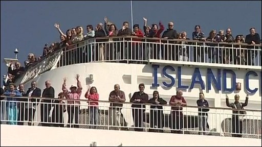 Passengers wave from Thomson cruise ship Island Escape