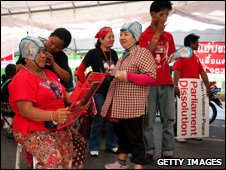 Red-shirts colour their hair at a makeshift hair saloon