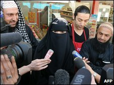 Muslim woman talks to reporters in Nantes