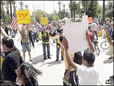 Supporters and opponents of the immigration bill square up in Phoenix, Arizona. Photo: 23 April 2010