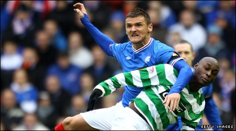 Rangers midfielder Lee McCulloch tussles with Marc-Antoine Fortune