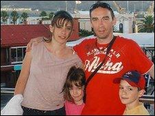 Andrew Bishton and his three children