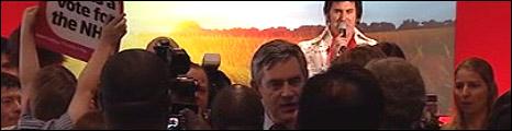 Gordon Brown is serenaded by an Elvis impersonator