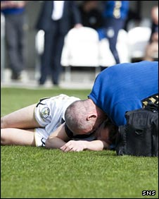 St Mirren midfielder Hugh Murray receives treatment