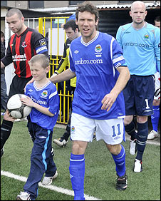 Noel Bailie leads out Linfield at Seaview to make his 1000th appearance for the Belfast club