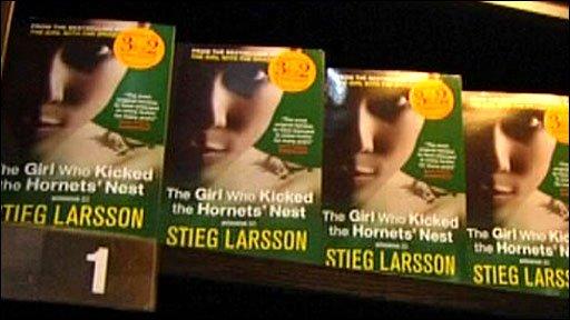 Stieg Larsson's novels on a shelf