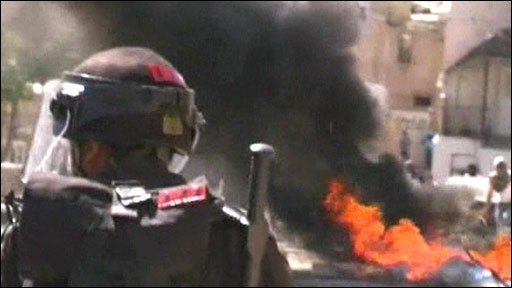 Israeli security forces and burning tyres