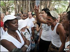 Cuban pro-government citizens surround and shout slogans to the Ladies in White in Havana