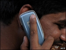 File picture of man using mobile phone in India