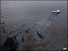 Boats with oil booms try to contain an oil spill in the Gulf of Mexico. Photo: 23 April 2010