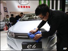 An employee polishes a car on the BYD stand in Beijing, China (23 April 2010)