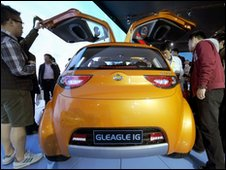 Beijing Car Show visitors inspect a Geely electric car (25 April 2010)