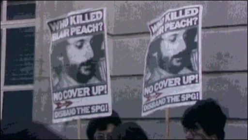 Protesters carry banners calling for justice for Blair Peach after his death in 1979
