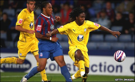 Neil Danns of Crystal Palace tackles Etienne Esajas of Sheffield Wednesday