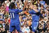 Drogba celebrates with Lampard following his goal
