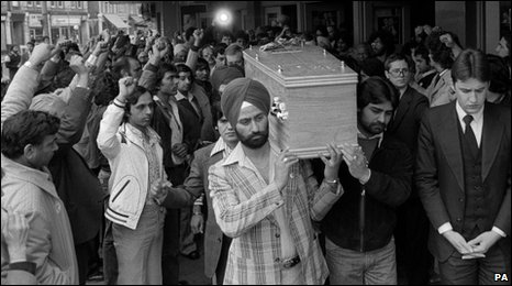 Bair Peach's coffin being carried during his funeral