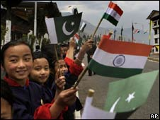 Bhutanese school girls hold flags of India and Pakistan as they wait for the arrival of dignitaries for the Saarc summit in Thimpu, Bhutan, on April 26, 2010