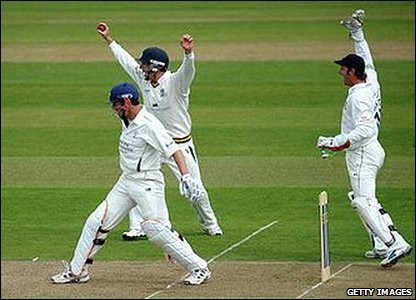 Will Smith and Phil Mustard celebrate the dismissal of Joe Sayers