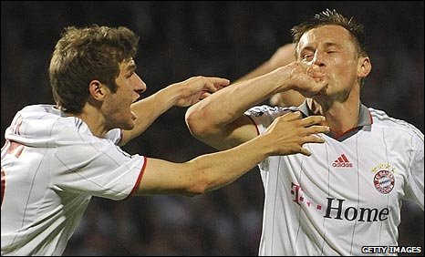 Ivica Olic (right) celebrates putting Bayern ahead
