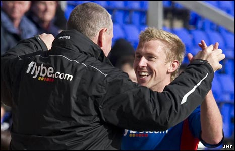 Terry Butcher and Richie Foran celebrate