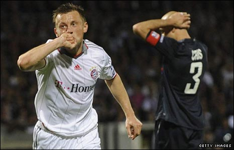 Ivica Olic of Bayern celebrates scoring against Lyon