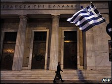 "A man walks outside the headquarters of bank of Greece during a demonstation against government""s austerity measures in central Athens"