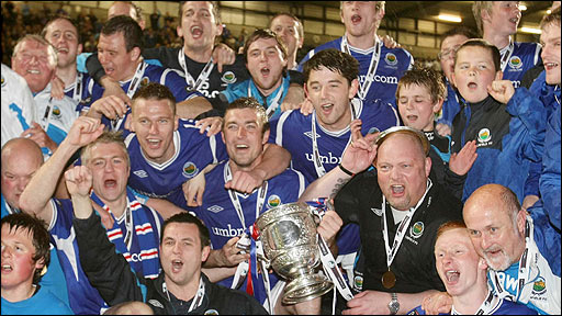 Linfield celebrates after their 1-0 win over Cliftonville clinched the Carling Premiership title