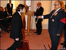 Peter Jackson (left) being knighted by by Governor-General Anand Satyanand
