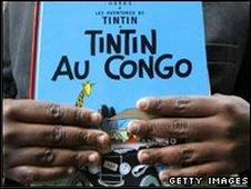 Protesting Congolese student holds copy of Tintin in the Congo