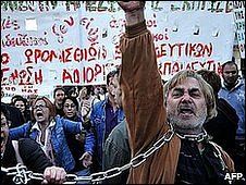 Demonstrators shout slogans against government's austerity measures during a protest outside the Greek Parliament in Athens on April 27, 2010