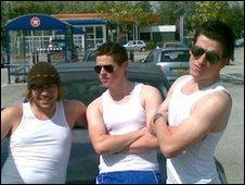 Three boys wearing sleeveless vests a la Bruce Willis in Die Hard