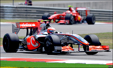 Heikki Kovalainen - then of McLaren - leads Kimi Raikkonen - then of Ferrari in Shanghai last year