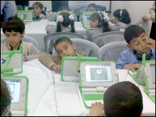 Children and laptops in Gaza (picture courtesy of UNWRA)