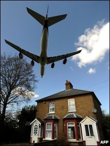 Plane over house (AFP)
