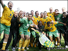Norwich celebrate after winning the League One title by beating Gillingham