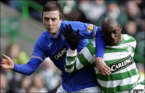 Rangers' Danny Wilson and Celtic's Marc-Antoine Fortune