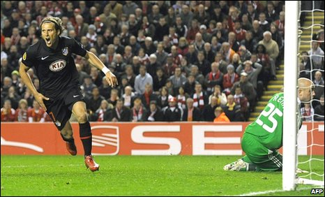Diego Forlan scores against Liverpool