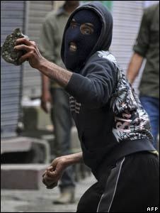Kashmiri protesters throw stones at the police in Srinagar on April 23, 2010