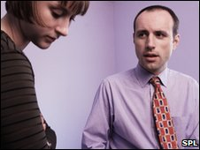 Man counselling woman