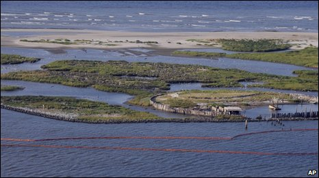 Containment booms lie off the coast of Plaquemines Parish, Louisiana, 29 April