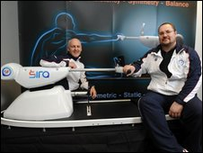 Robert Clarke (L) and John Lockwood (R) show off their Sira machine