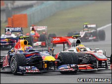 Mark Webber and Lewis Hamilton bang wheels at the Chinese Grand Prix