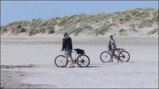 Cyclists on beach