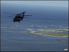 A US Coast Guard helicopter flies over Plaquemines Parish, 29 April