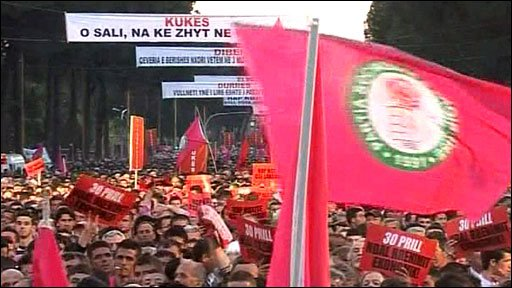 Protesters in Tirana wave Socialist party flags