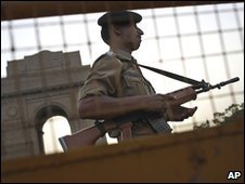An Indian police officer stands guard near India Gate in New Delhi