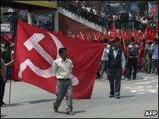 Nepalese Maoists wave flags during a procession in Kathmandu, 1 May 2010