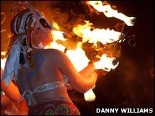Beltane performer and lit torches